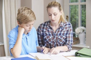 side hustles for college students: a tutor helping a student